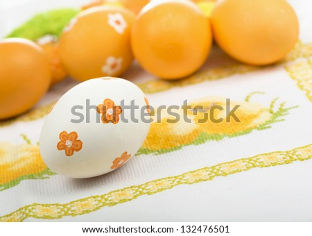 Easter eggs on the embroidered cloth - stock photo