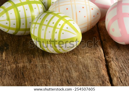 Easter eggs on vintage wooden background  - stock photo
