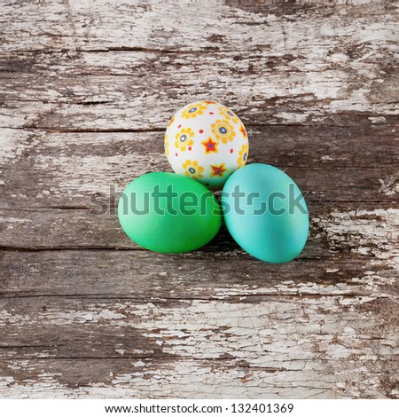 easter eggs on wood background - stock photo