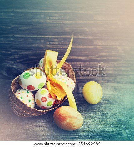 Easter eggs on wooden background/ easter holidays background - stock photo