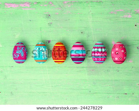 Easter eggs on wooden table background with copy space - stock photo