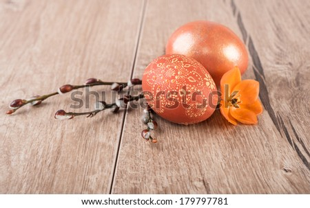 Easter eggs on wooden table, text space, shallow DOF, focus on the front egg - stock photo
