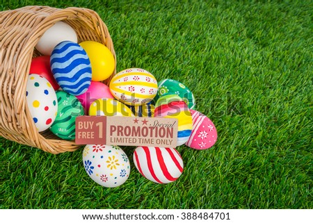 Easter eggs Sale Coupon, voucher, tag on Fresh Green Grass