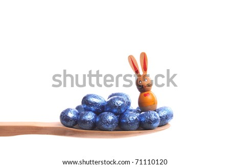 Easter eggs simply offered on a wooden spoon isolated on a white background - stock photo