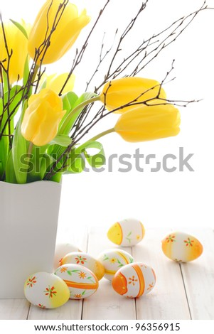 Easter eggs,tulips,silver-bud willow,Happy easter. - stock photo