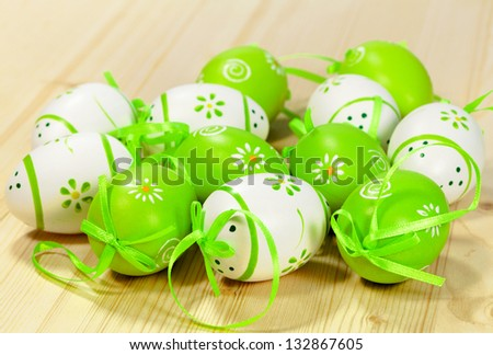 Easter eggs, various colors white and green on wood