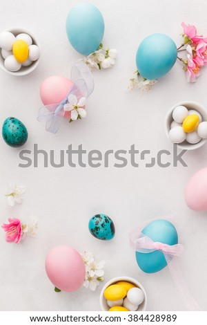 Easter eggs. Various pastel colored Easter eggs, candies and decorations.   Macro, selective focus, top view, blank space - stock photo