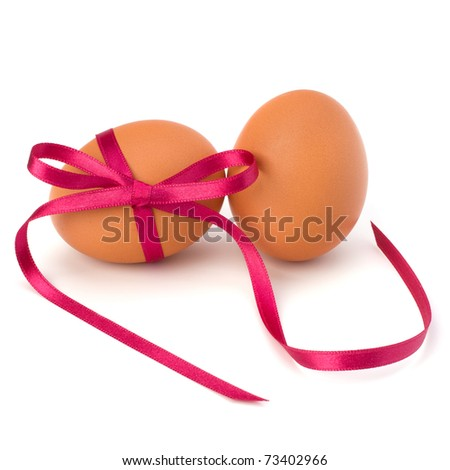 Easter eggs with festive bow isolated on white background - stock photo