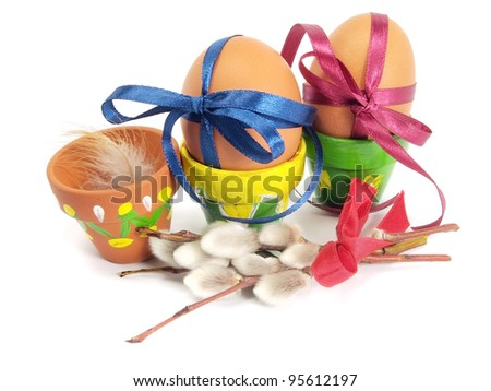 Easter eggs with festive bow on a white background