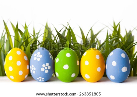 Easter Eggs with flower on Fresh Green Grass over white background - stock photo