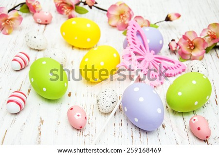 Easter eggs with flowers on a old wooden background - stock photo