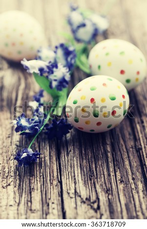 easter eggs with flowers on rusty background   - stock photo