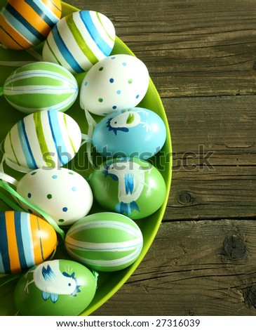 Easter eggs with ornament on wooden - stock photo