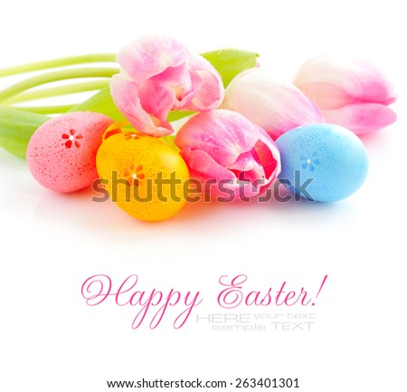 Easter eggs with pink tulip flowers on white background - stock photo