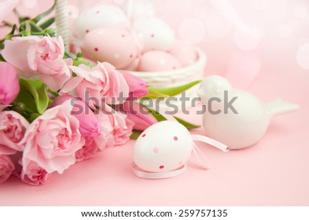 Easter eggs with spring flowers. - stock photo