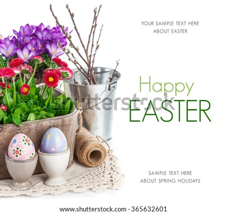 Easter eggs with spring flowers in basket. Isolated on white background - stock photo