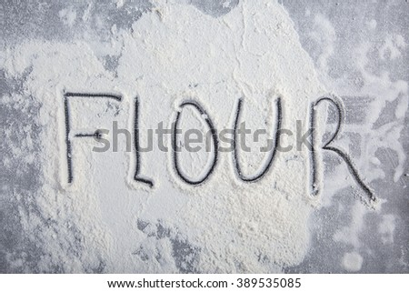 Easter flour on wooden background and metal texture.