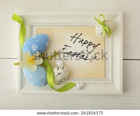 easter frame with copy space. colorful easter eggs and spring flowers - stock photo