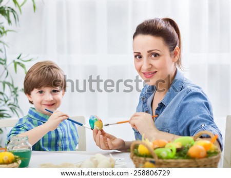 Easter fun and enjoy at home, painting eggs - stock photo
