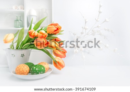 Easter greeting card design with bunch of tulips and painted eggs on abstract white background - stock photo