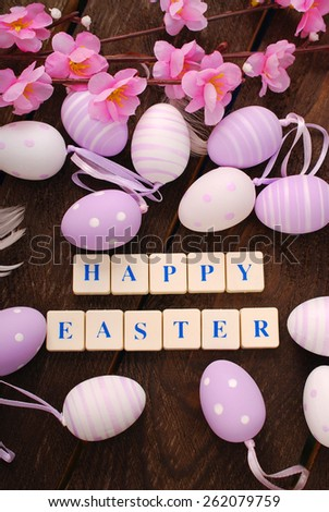 easter greeting card made with letter cubes and eggs on wooden background  - stock photo