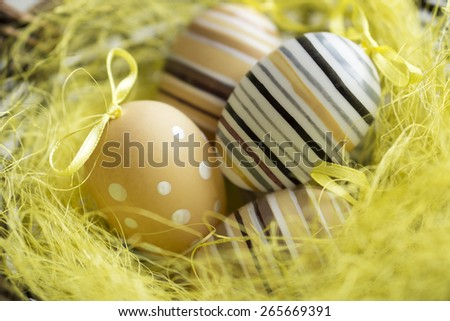 Easter greeting card with colorful easter eggs in basket - stock photo
