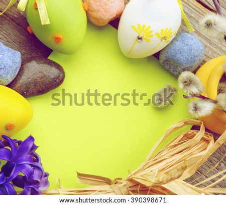Easter Greeting Card with Pussy-Willow, Colored Stones, Crocus, Easter Eggs and Empty Green Place to Congratulations closeup. Retro Styled