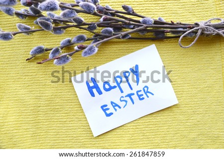 "Easter greeting card with words""happy Easter"", easter eggs,  pussy willow on tablecloth - stock photo"