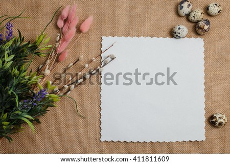 Easter greetings. Easter egg and flowets on the table