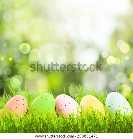 Easter greetings with grass and eggs with copy space - stock photo