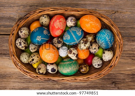 Easter hand painted eggs in basket - stock photo