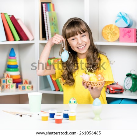 Easter holiday - beautiful little girl with Easter eggs at home - stock photo