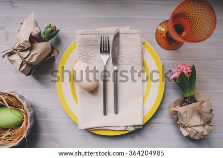 Easter holiday dinner at home. Table setting top view. Handmade decoration details with hyacinth flowers and eggs. - stock photo