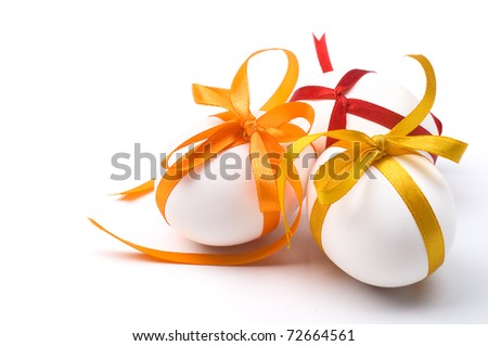 Easter holiday eggs with bows and space for text - stock photo