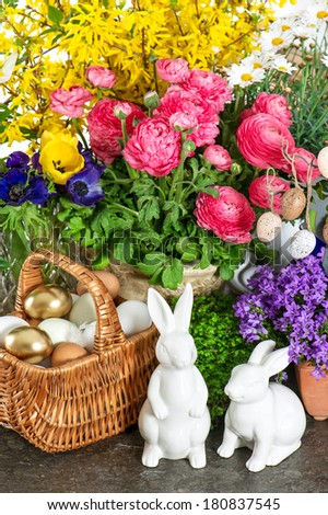 easter home interior decoration with spring fresh flowers and blossoms - stock photo