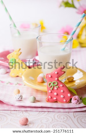 Easter homemade cookies decorated with icing and glasses of milk - stock photo