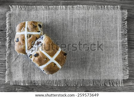 easter hot cross buns on burlap cloth - stock photo