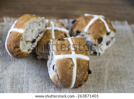 easter hot cross buns on burlap cloth  with shallow depth of field - stock photo