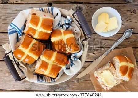 Easter Hot Cross Buns, overhead scene on a rustic wood background - stock photo
