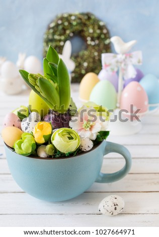 Easter hyacinth comrosition with eggs and flowers in a mug.