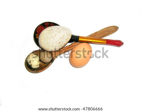 easter illustration: wood spoons and exotic  eggs isolated on white - stock photo