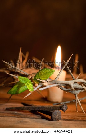 Easter image of a crown of thorns, a candle and green leaf of Hope - stock photo