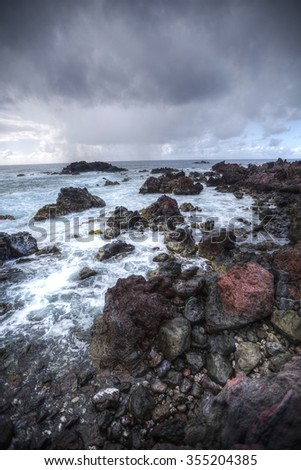 Easter Island rocky coast. The waves of the Pacific Ocean