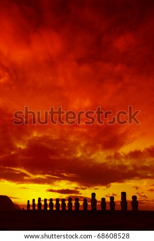Easter Island statues against dramatic red sunset - stock photo