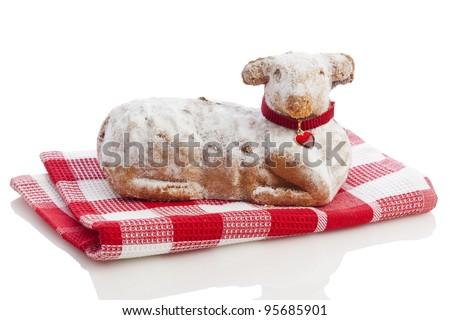 Easter Lamb Cake on red towel isolated on white