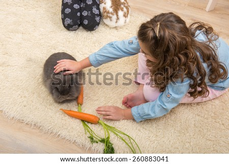 Easter - Little girl loves live rabbit