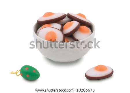 Easter marzipan eggs on white background.