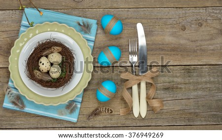 Easter nest in a plate on a wooden background - stock photo