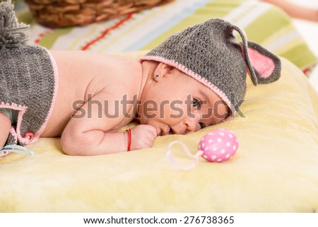 Easter newborn baby girl in crochet bunny costume - stock photo