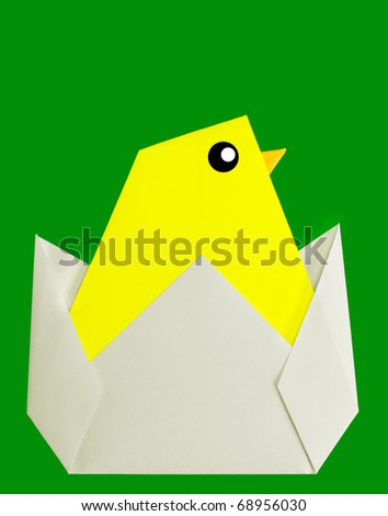 Easter or spring chick,  origami on green